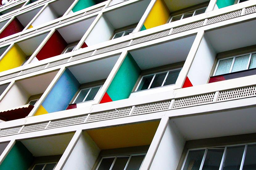 angled shot of multicolored apartment balconies