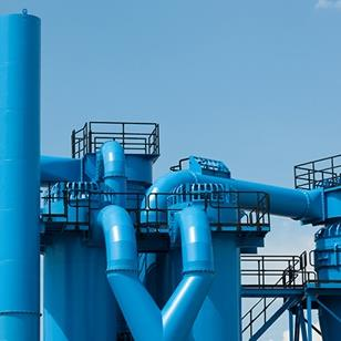 exterior shot of industrial facilitys blue pipes